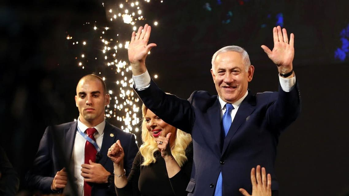 Israeli PM Benjamin Netanyahu and his wife Sara react following the announcement of exit polls in Israel's parliamentary election at the party headquarters in Tel Aviv, Israel on April 10, 2019. (Reuters)