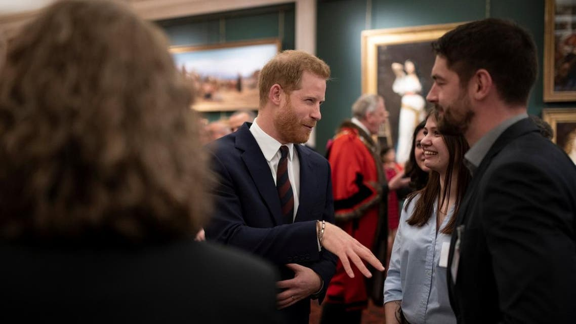 Britain's Prince Harry meets guests as he attends the Lord Mayor's Big Curry Lunch, in aid of the three national service charities, at the Guildhall in London, on April 4, 2019. (Reuters)