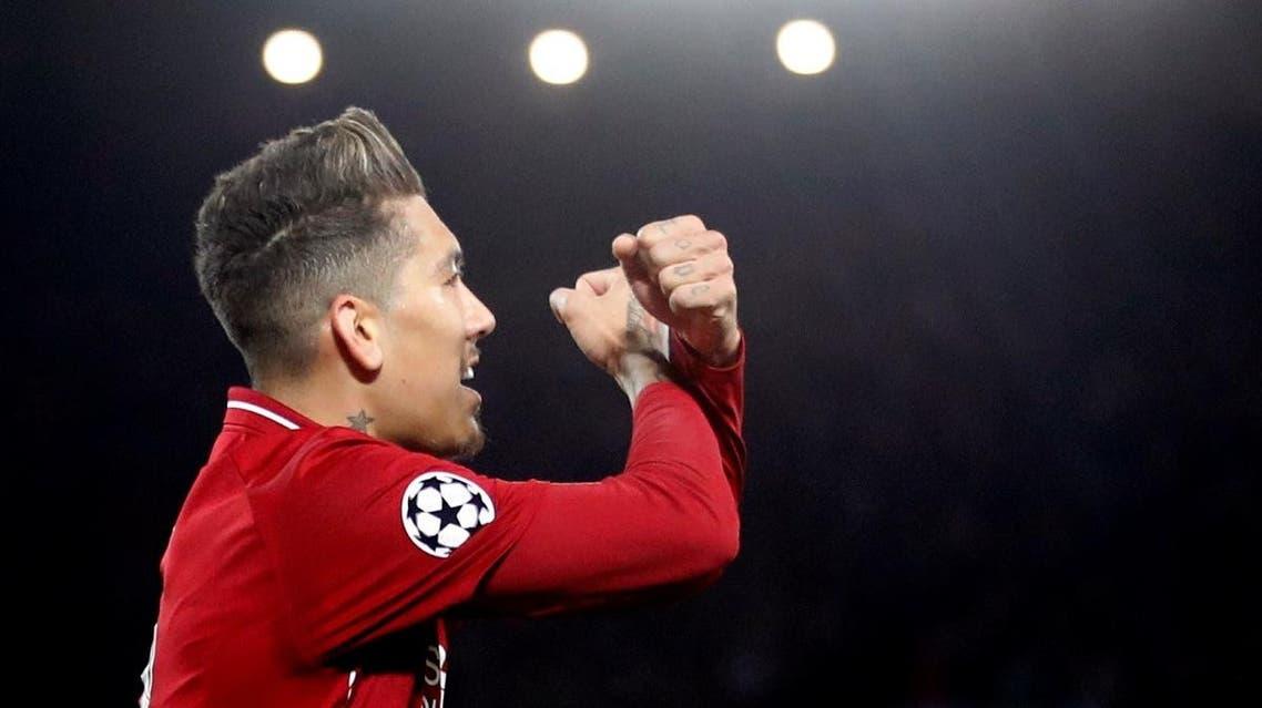 Liverpool's Roberto Firmino celebrates scoring their second goal. (Reuters)