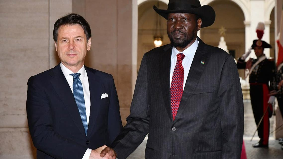 Italy's Prime Minister Giuseppe Conte (L) shakes hand with South Sudan President Salva Kiir on April 10, 2019 at the Chigi Palace in Rome. (AFP)