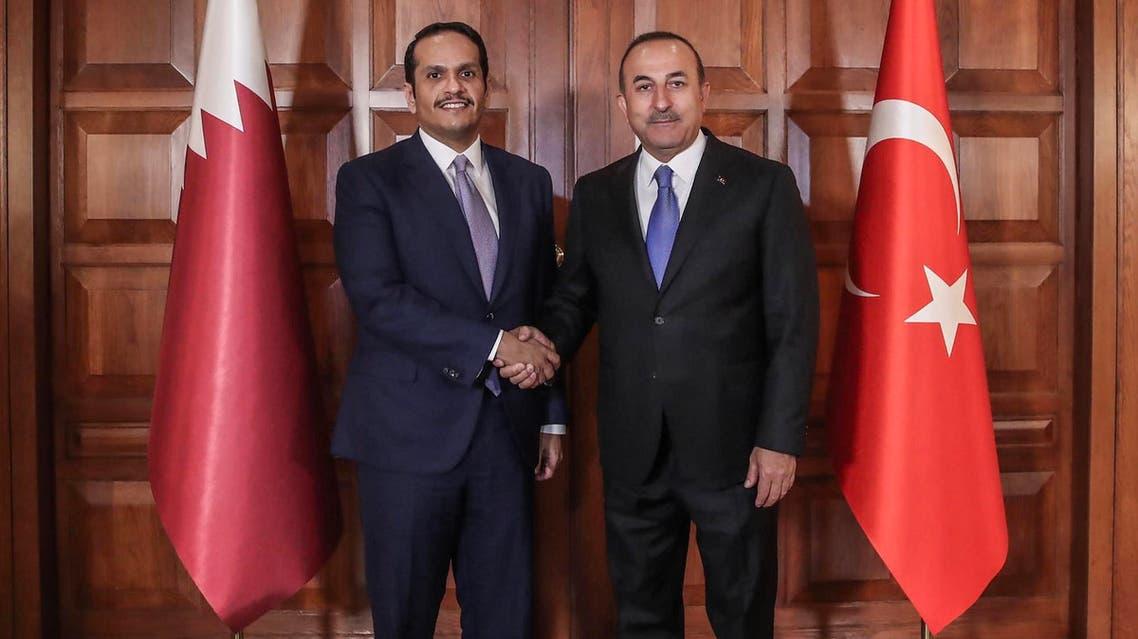 Mevlut Cavusoglu (R) with Mohammed bin Abdulrahman al-Thani (L) in Ankara on April 9, 2019. (AFP)
