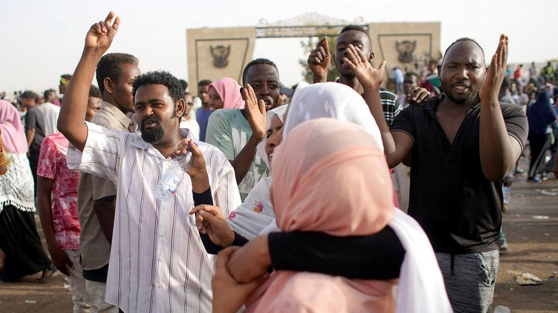 Sudanese demonstrators chant slogans as they protest against the army's announcement that President Omar al-Bashir would be replaced by a military-led transitional council, in Khartoum on April 11, 2019. (Reuters)