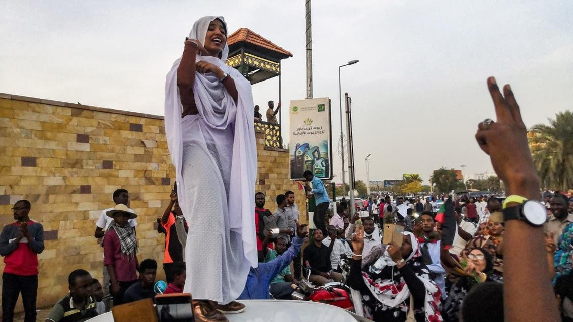 Alaa Salah addresses protesters in front of the military headquarters in the capital Khartoum. (AFP)