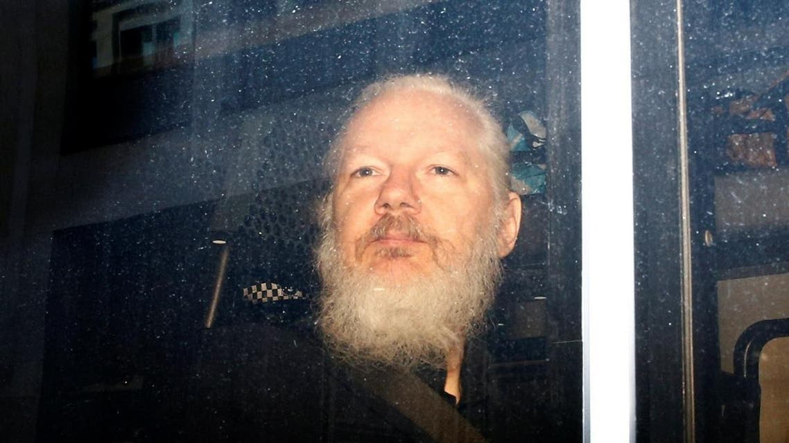 WikiLeaks founder Julian Assange is seen in a police van, after he was arrested by British police, in London. (Reuters)