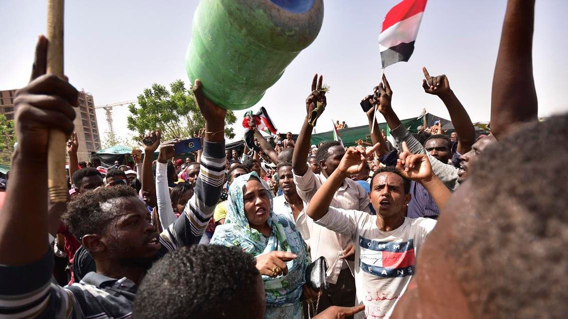 Sudanese demonstrators gather in a street in central Khartoum on April 11, 2019, after long-serving president Omar al-Bashir was ousted by the army. (AFP)