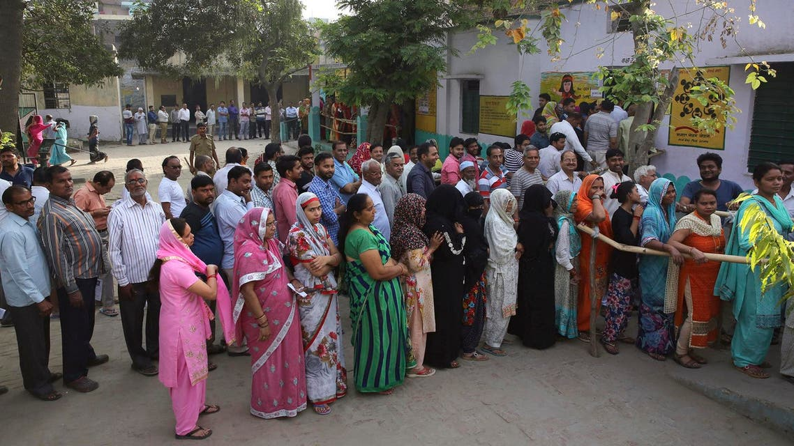 Indians stand in queues to cast their votes for the first phase of general elections, near Ghaziabad, on April 11, 2019. (AP)