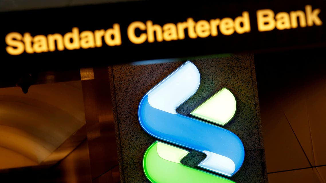 FILE PHOTO: FILE PHOTO: A logo of Standard Chartered is displayed at its main branch in Hong Kong, China August 1, 2017. REUTERS/Bobby Yip/File Photo