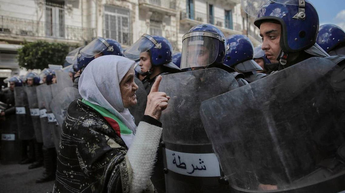 An elderly woman confronts security forces during a demonstration in Algiers, Algeria, Wednesday, April 10, 2019. (AP)