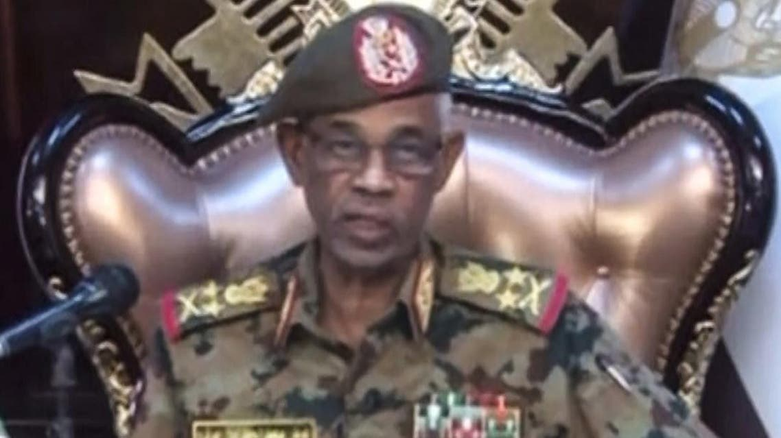 A grab from a live broadcast on Sudan TV shows Sudanese Defense Minister Ahmed Awad Ibnouf delivering a speech in Khartoum, announcing that President Omar al-Bashir was removed from power on April 11, 2019. (AFP)