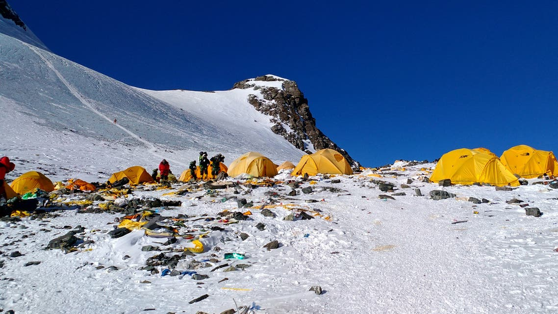 (FILES) This file picture taken on May 21, 2018 shows discarded climbing equipment and rubbish scattered around Camp 4 of Mount Everest. Climbers with pressing needs on Mount Everest will soon find an eco-friendly toilet at a Chinese campsite 7,028 metres (23,058 feet) above sea level in an ongoing campaign to deal with the peak's waste problem, it was reported on April 12, 2019.