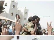 """صورة العسكري السوداني """"الجياشي"""" وابنه الثائر تشعل التواصل"""
