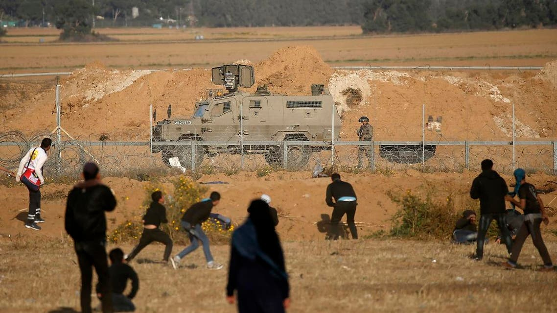 Palestinian take cover from Israeli forces during a demonstration near the border with Israel, east of Khan Yunis in the southern Gaza Strip, on April 12, 2019. (AFP)