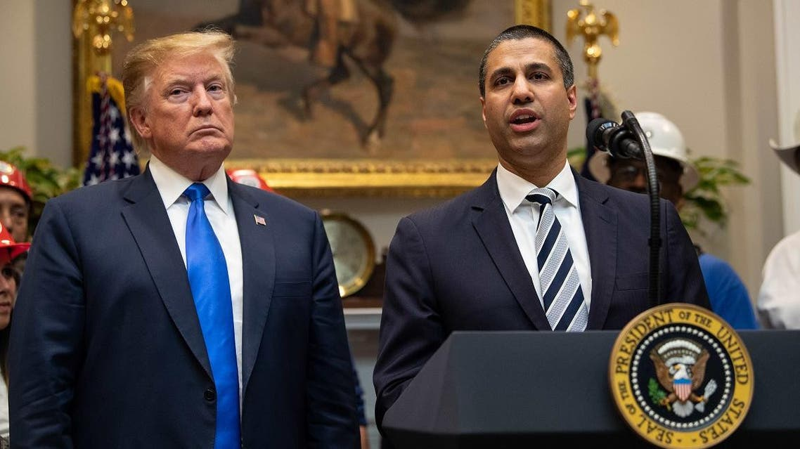 US President Donald Trump listens to Federal Communications Commission (FCC) chairman Ajit Pai speak during an announcement about 5G network deployment in the Roosevelt Room at the White House in Washington, DC, on April 12, 2019. (AFP)