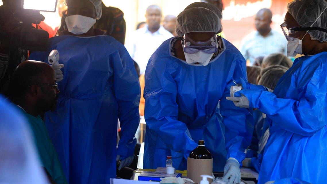 Healthcare workers from the World Health Organization prepare to give an Ebola vaccination to a front line aid worker in Beni Democratic Republic of Congo, Friday, Aug 10, 2018.  (AP)