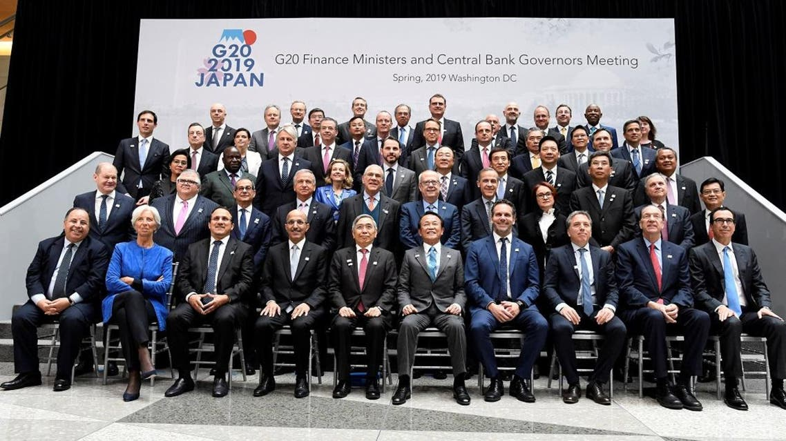 Finance ministers and central bank governors gather for a group photo during the IMF and World Bank's 2019 Annual Spring Meetings, in Washington, April 12, 2019. (Reuters)