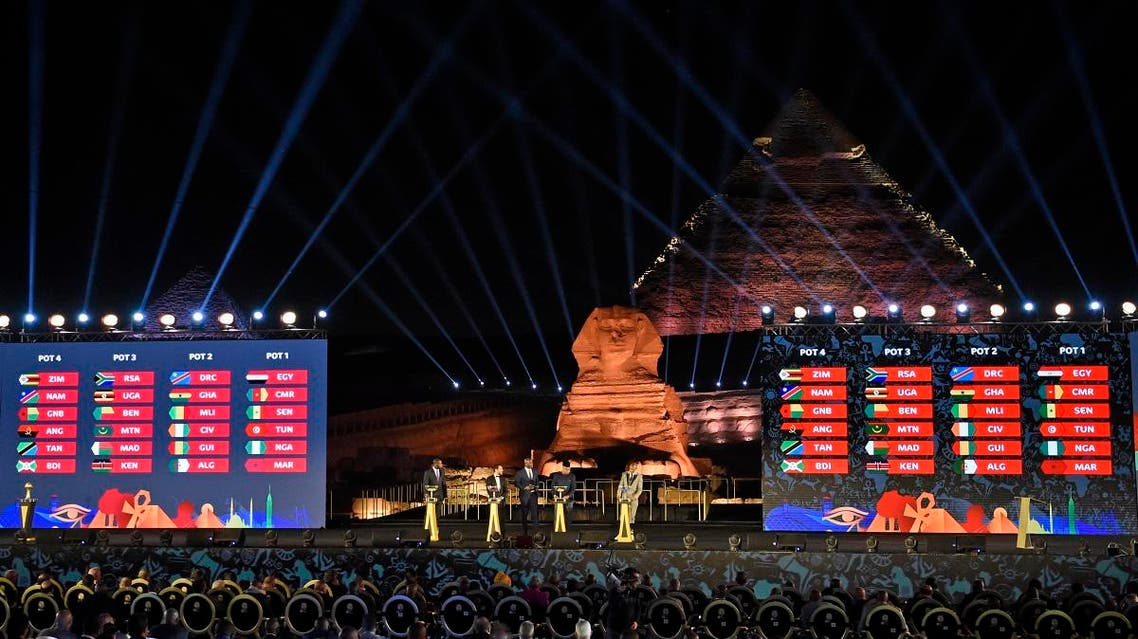 This picture taken on April 12, 2019 during the 2019 CAF African Cup of Nations (CAN) draw ceremony shows the pots' composition with the Pyramid of Khafre (Chephren) and the Sphinx in the background at the Giza Pyramids Necropolis on the western outskirts of the Egyptian capital Cairo. KHALED DESOUKI / AFP