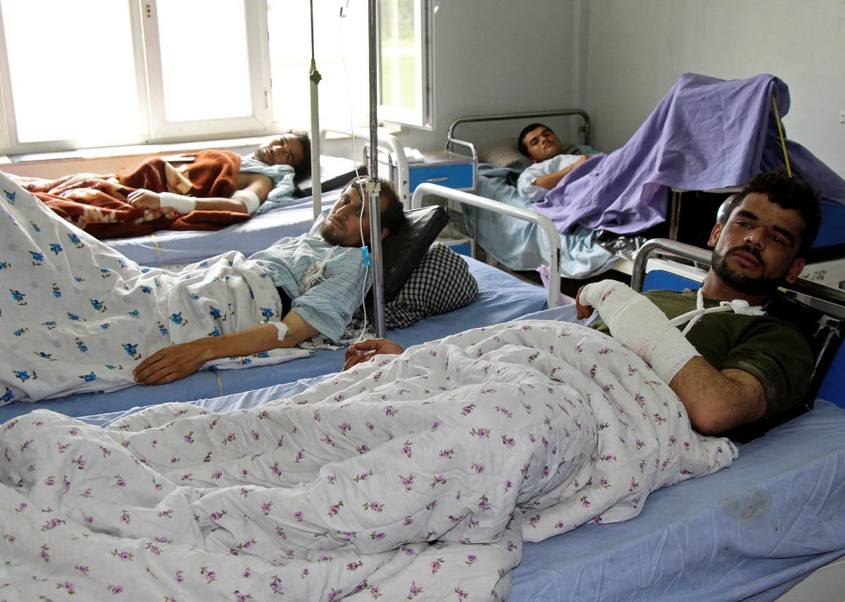 Wounded Afghan men receive treatment at a hospital one day after the start of the Taliban spring offensive, in Kunduz province, Afghanistan. (Reuters)