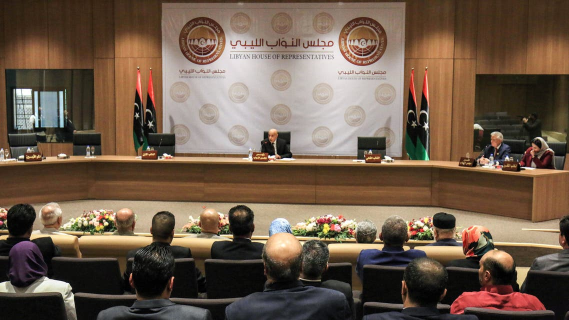 Aguila Saleh Issa (C), speaker of Libya's fomerly-Tobruk-based House of Representatives which was elected in 2014, chairs the first session for the assembly at its new headquarters in the second city of Benghazi in the eastern part of the country controlled by strongman Khalifa Haftar, on April 13, 2019.