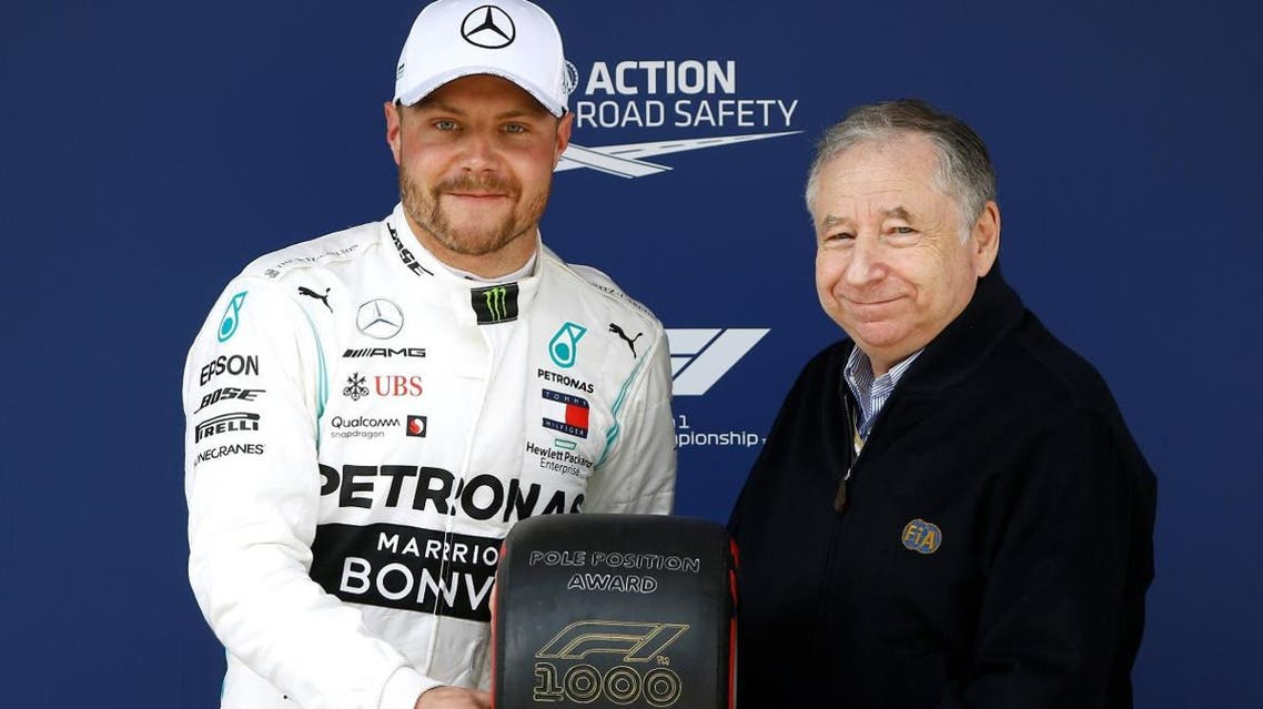 Mercedes' Valtteri Bottas is presented with the pole position award by FIA President Jean Todt after qualifying on April 13, 2019. (Reuters)
