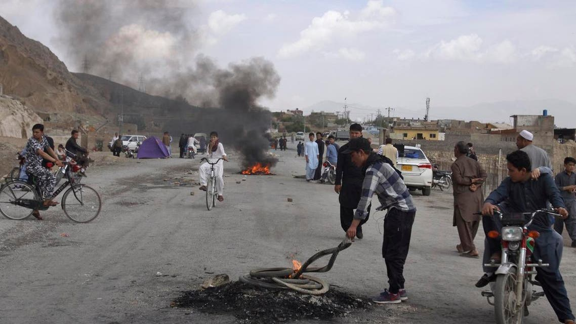 Pakistani Shiite youth from Hazara community burn tires to block a main road during a protest to condemn Friday's suicide bombing in Quetta, Pakistan, on  April 13, 2019. (AP)