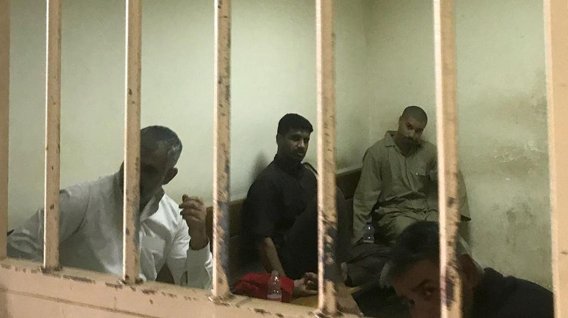 File photo of suspected ISIS members sits inside a cell at a court in Baghdad on May 10, 2018. (AFP)