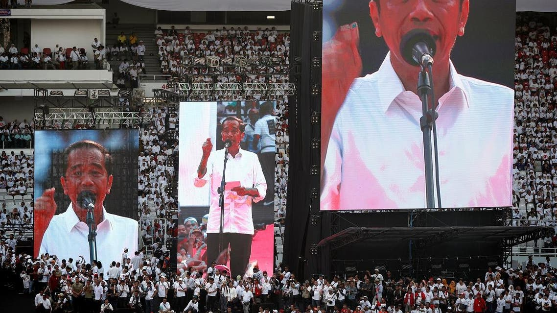 Indonesia's President Joko Widodo addresses supporters at a rally at Gelora Bung Karno Stadium in Jakarta. (Reuters)