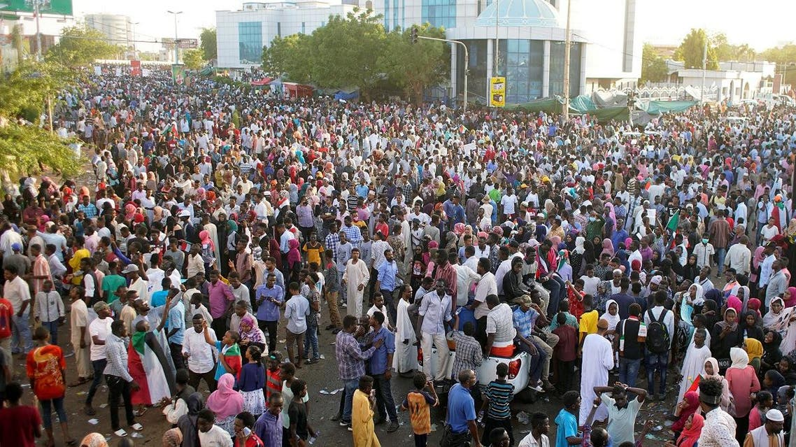 Sudanese demonstrators gather to celebrate after Defence Minister Awad Ibn Auf stepped down as head of the country's transitional ruling military council. (Reuters)