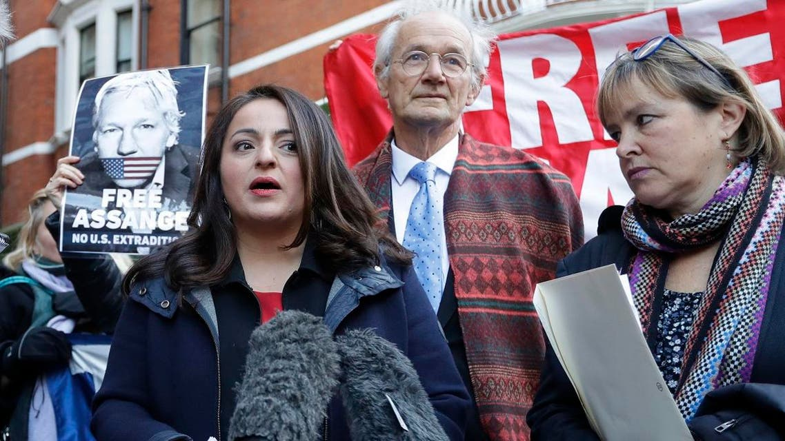 German MP Sevim Dagdelen, left, speaks to the media alongside John Shipton, biological father of Julian Assange, and German MP Heike Hansel, right, outside the Ecuadorian embassy in London, Thursday, Dec. 20, 2018. (AP)