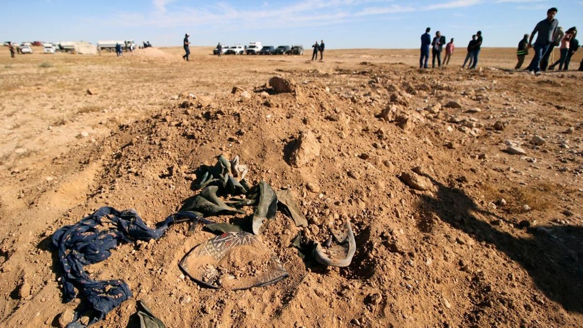Bits of clothing are seen after they were unearthed from a mass grave of Kurds in west of the city of Samawa, Iraq. (Reuters)