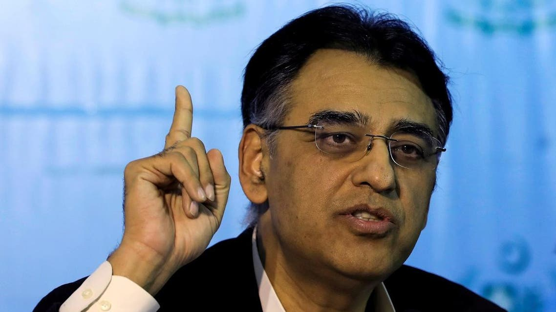 Pakistan's Finance Minister Asad Umar gestures during a news conference in Islamabad. (Reuters)