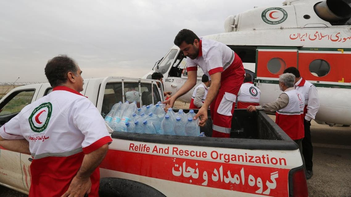 Iranian Red Crescent volunteers prepare to distribute aid on April 09, 2019 to people in Ahvaz, the capital of the southwestern Iranian province of Khuzestan which has been badly affected by flooding over the past few weeks. (AFP)