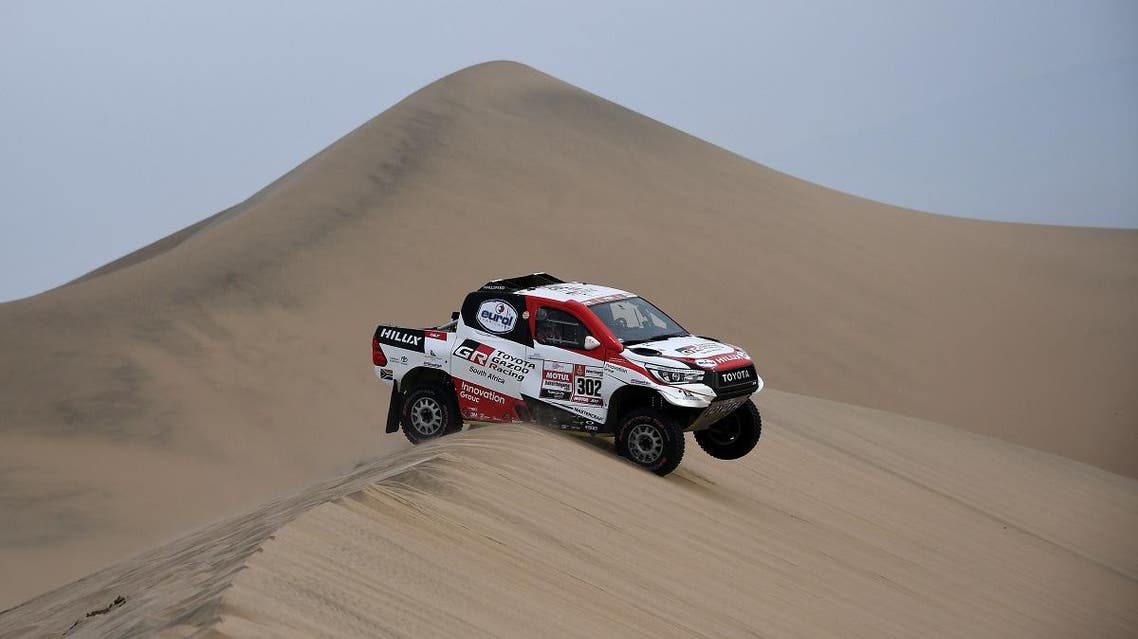 Toyota's driver Giniel De Villiers of South Africa and his co-driver Dirk Von Zitzewitz of Germany compete, during the Stage 9 of the Dakar 2019 in and around Pisco, Peru. (AFP)