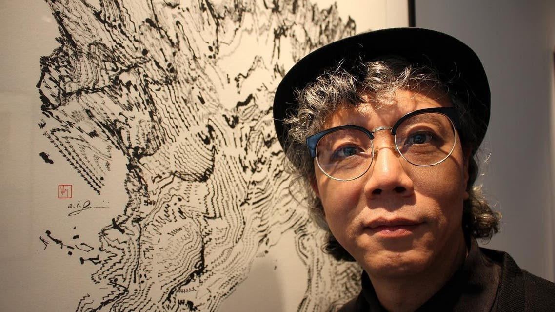 Hong Kong artist Victor Wong stands during his exhibition 'Far Side of the Moon' at 3812 Gallery in London, Britain April 16, 2019. (Reuters)