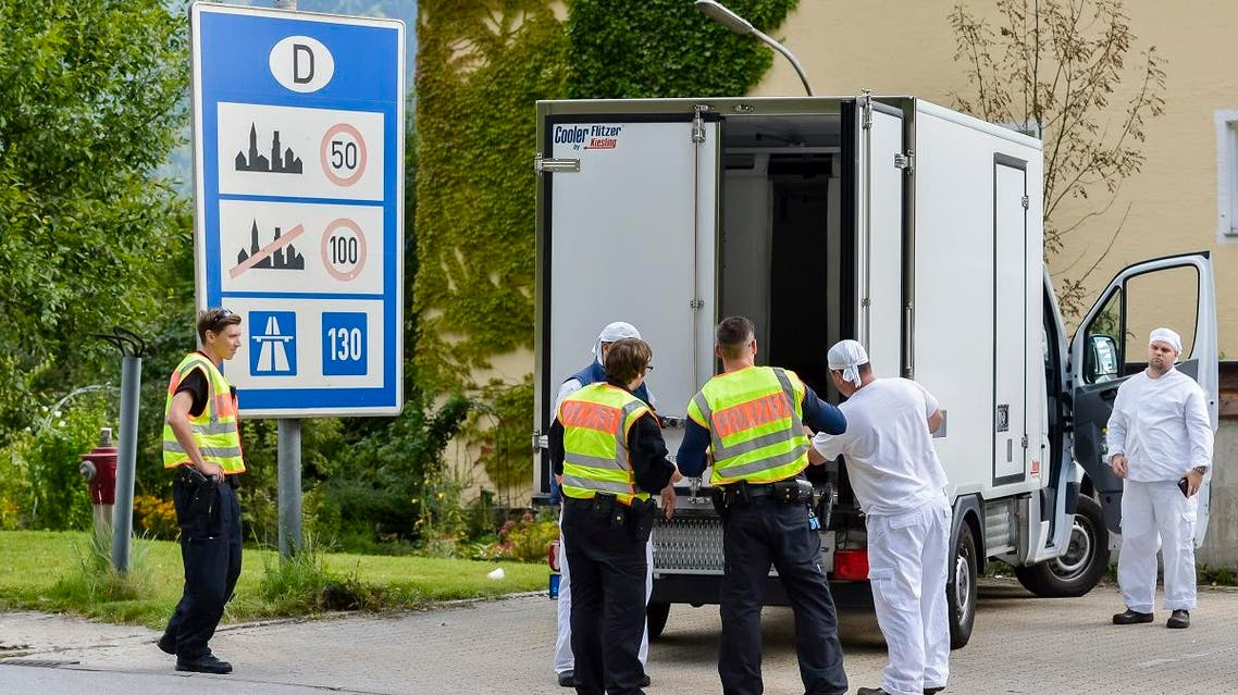 German police officers check a refrigerated truck at the check point during a border control on the border crossing between Austria and Germany at the southern German city of Kiefersfelden on September 16, 2015. (AFP)