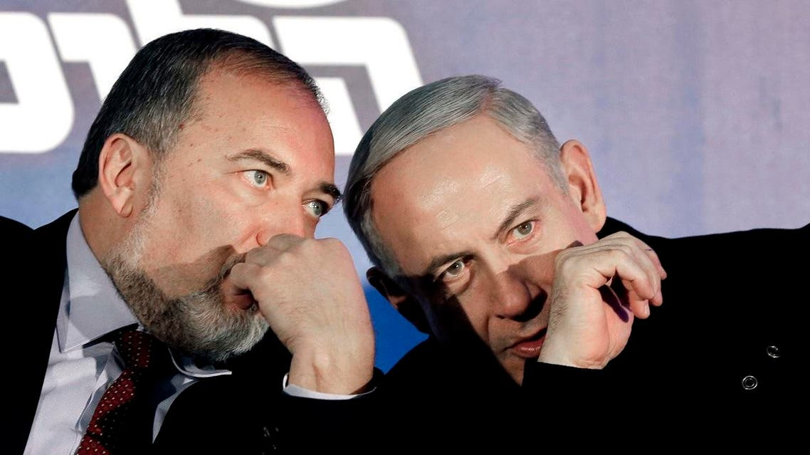 In this Wednesday, Jan. 16, 2013 file photo, Prime Minister Benjamin Netanyahu, right, and former Foreign Minister Avigdor Lieberman speak during a Likud-Yisrael Beitenu campaign rally in the port city of Ashdod. (AP)