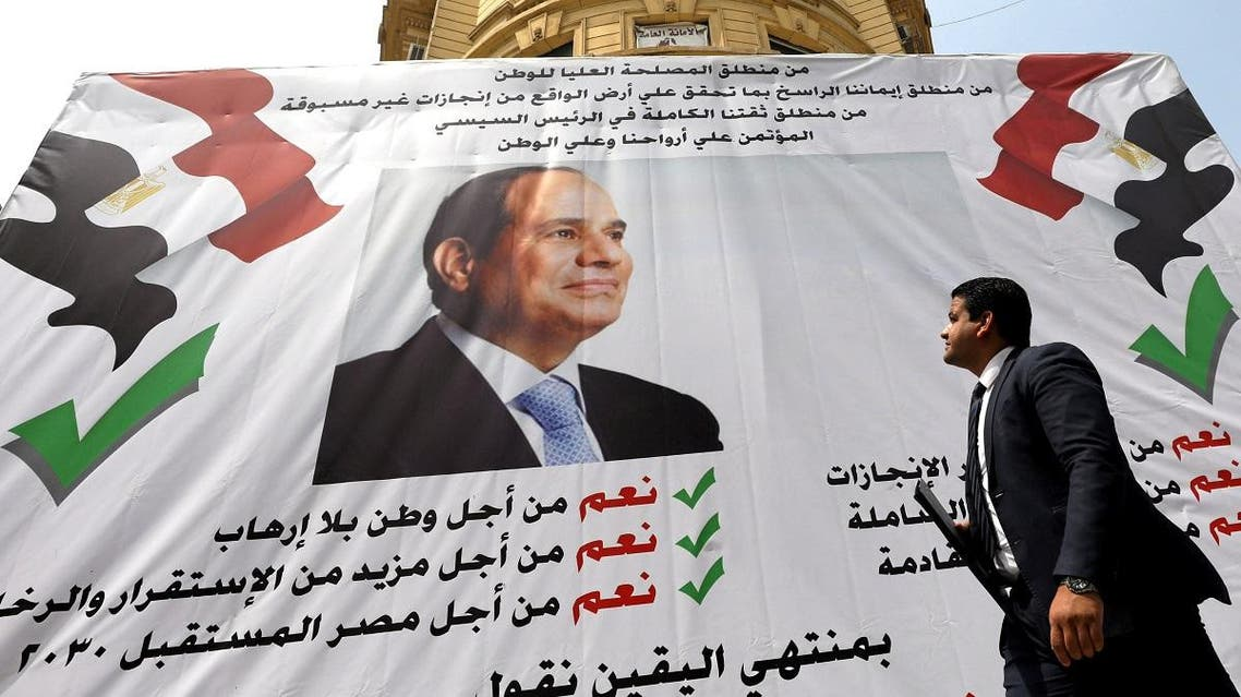 """A man walks in front of a banner reading, """"Yes to the constitutional amendments, for a better future"""", with a photo of the Egyptian President Abdel Fattah al-Sisi before the approaching referendum on constitutional amendments in Cairo. (Reuters)"""