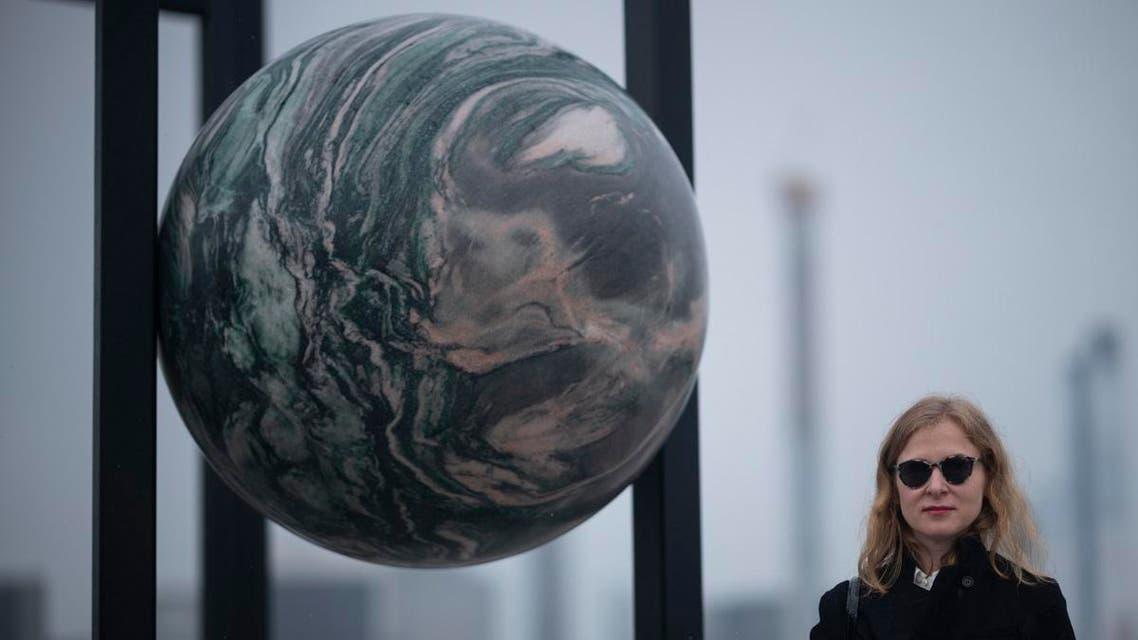 Berlin-based artist Alicja Kwade poses in her sculpture ParaPivot atop the Metropolitan Museum of Art. (AFP)