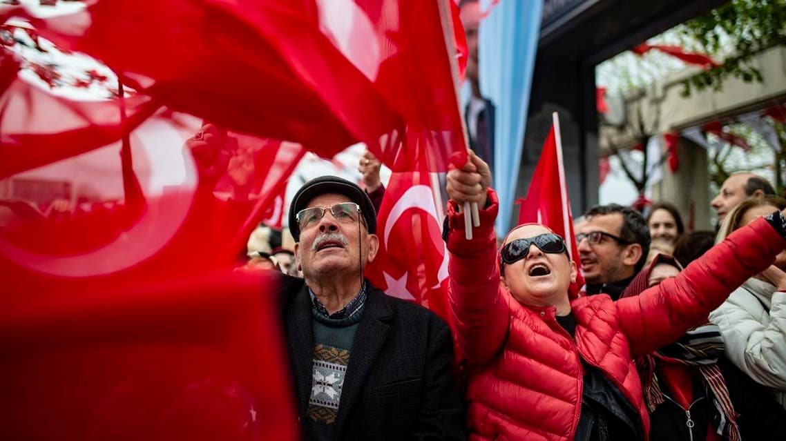 Supporters listen to main opposition Republican People's Party (CHP) mayoral candidate, Ekrem Imamoglu (unseen), during a rally following local elections in the Turkish city of Istanbul. (AFP)