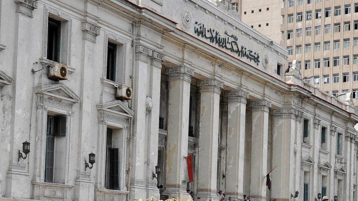 Egyptian soldiers stand guard outside Alexandria courtroom during the trial (AFP)