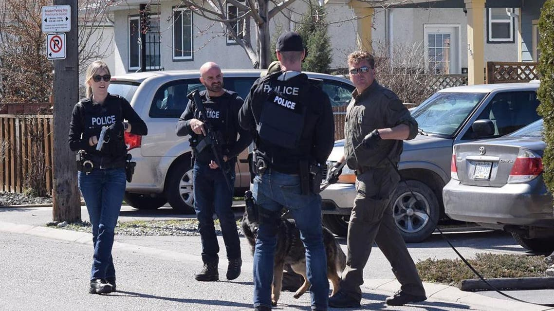Royal Canadian Mounted Police (RCMP) officers search for a suspect after a series of attacks in which four people were shot dead, in Penticton. (Reuters)