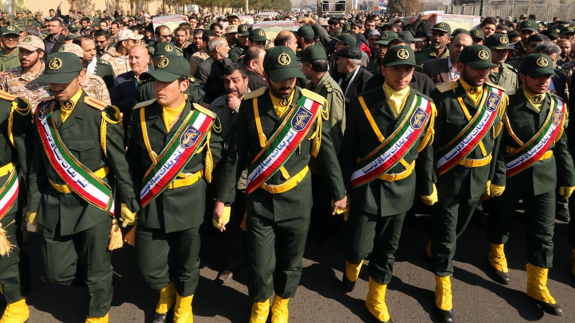 Members of the Iranian Revolutionary Guard carry the casket of Iran's Revolutionary Guards Brigadier General Mohsen Ghajarian, who was killed in the northern province of Aleppo by jihadists in Syria, during their funeral procession in the capital Tehran, on February 6, 2016. Brigadier General Mohsen Ghajarian of the elite Revolutionary Guards was killed in the northern province of Aleppo, according to the Fars news agency, which is close to the Guards. He was advising pro-government forces in the fight against the Islamic State (IS) jihadist group, it reported, without saying when he died.