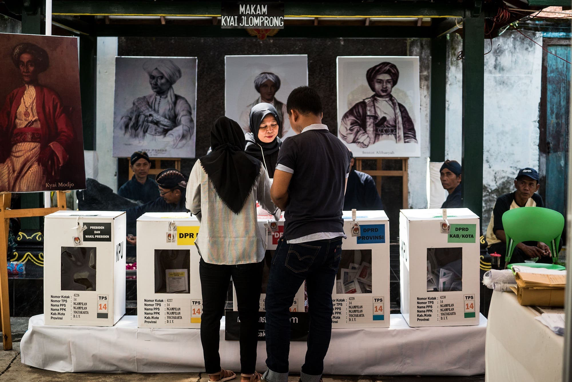 People cast their votes at a polling station during Indonesia's general election in Yogyakarta on April 17, 2019. (AFP)