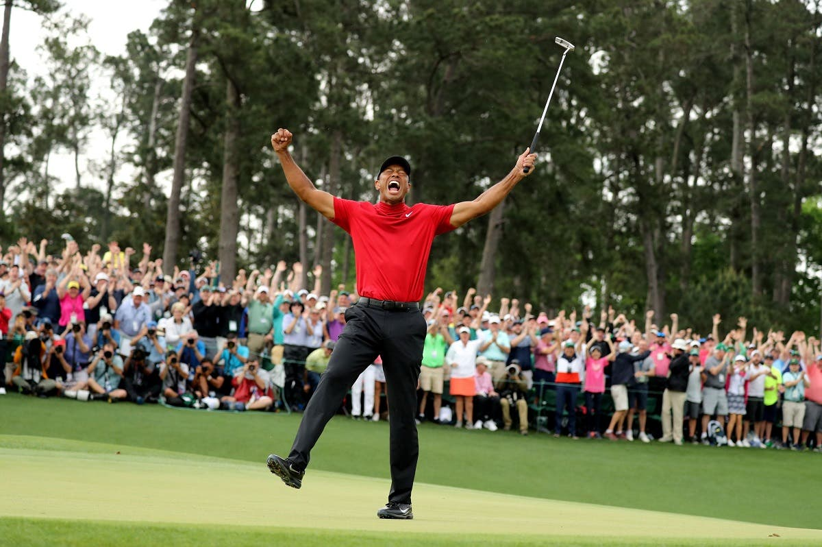 Tiger Woods celebrates on the 18th hole after winning the 2019 Masters. (Reuters)