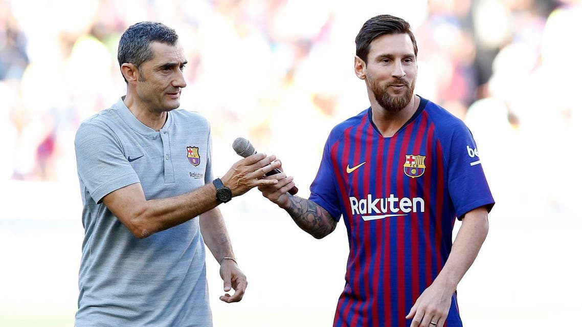 Lionel Messi and Ernesto Valverde at the Camp Nou stadium in Barcelona on Aug. 15, 2018. (AP)