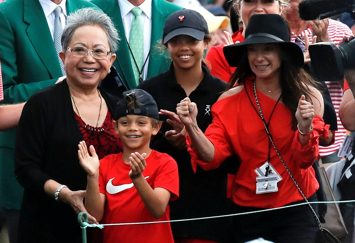 Tiger Woods' family, daughter Sam Alexis, son Charlie Axel, mother Kultida Woods (L) and girlfriend Erica Herman, smile has he approaches them after he won the 2019 Masters. (Reuters)