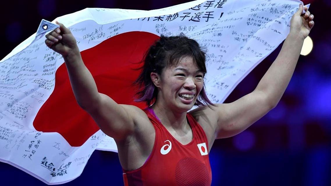 Risako Kawai of Japan celebrates her win over Elif Yesilirmak of Turkey in the final of women's 59kg category of the Wrestling World Championships in Budapest on Oct. 23, 2018. (AP)