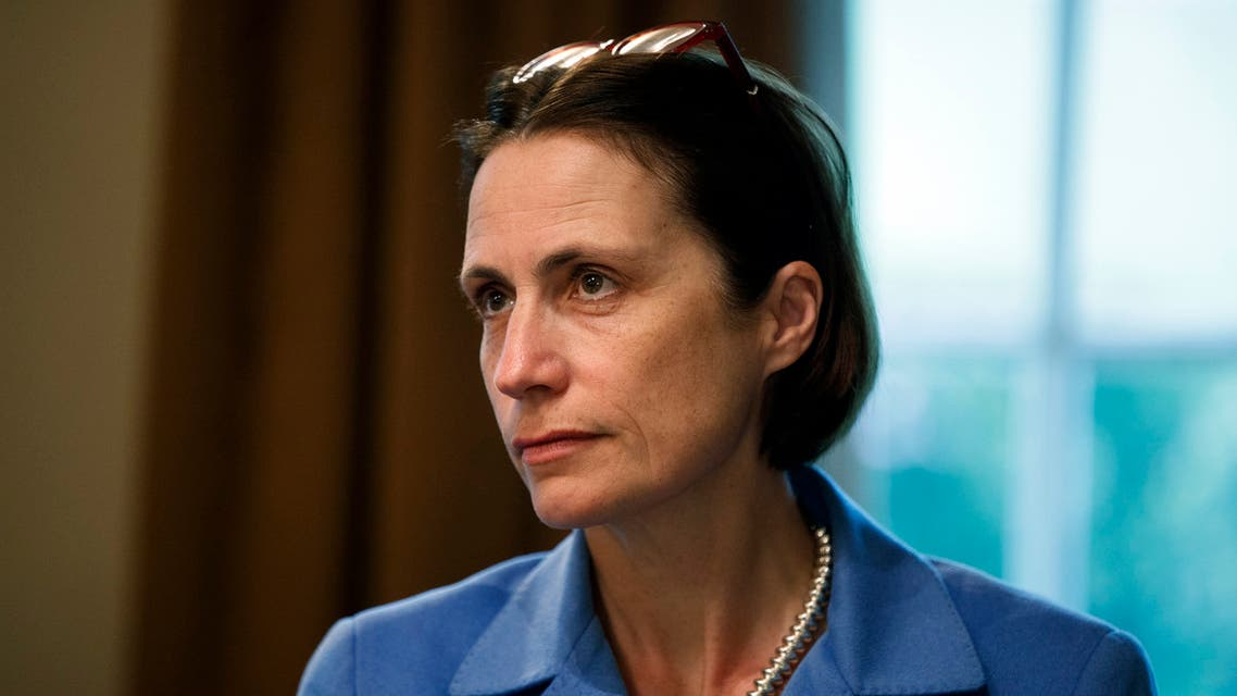 Fiona Hill, senior director for European and Russian Affairs on the National Security Council, listens as President Donald Trump speaks during a meeting NATO Secretary General Jens Stoltenberg in the Cabinet Room of the White House, Tuesday, April 2, 2019, in Washington. (AP Photo/Evan Vucci)