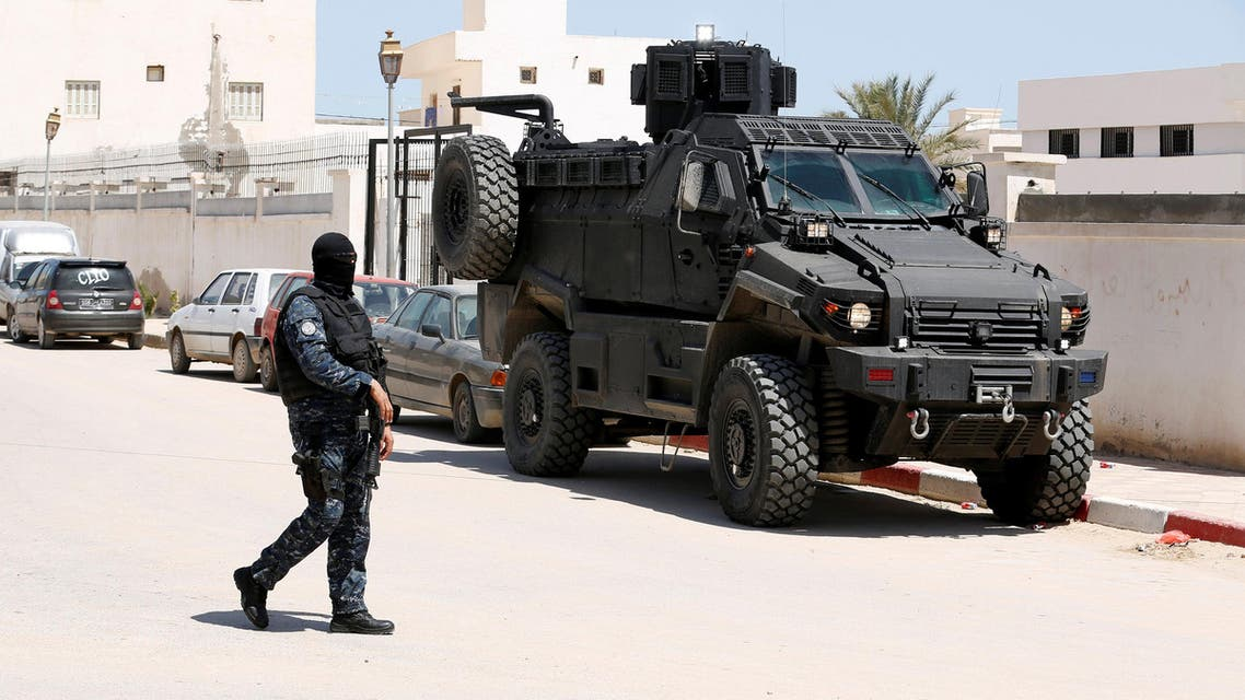 A police officer stands guard in the town of Ben Guerdane, near the Libyan border in Tunisia, on April 16, 2019. (Reuters)