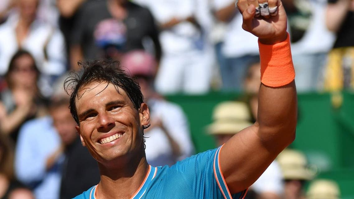 Rafael Nadal celebrates after winning against Spain's Roberto Bautista Agut at then end of their tennis match on the day 5 of the Monte-Carlo ATP Masters Series tournament on April 17, 2019 in Monaco. (AFP)
