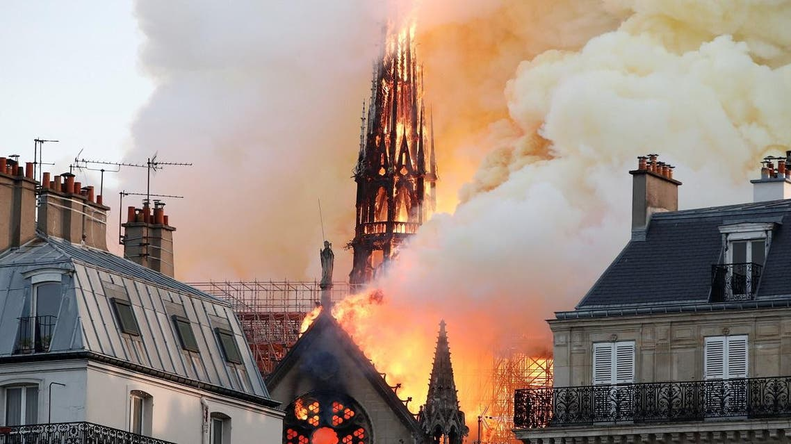 Smoke billows as fire engulfs the spire of Notre Dame Cathedral in Paris. (Reuters)